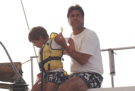 son-and-father-on-boat